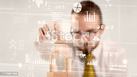 452598975 istock photo Businessman building a tower 1170667668