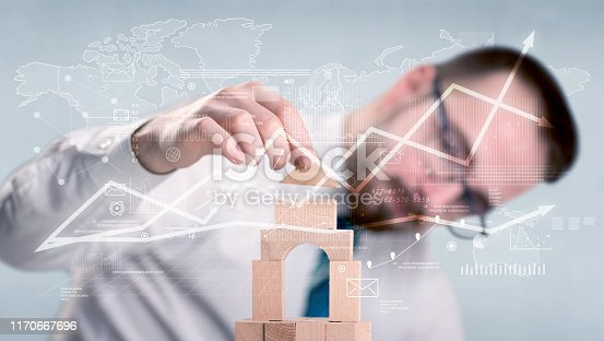 452598975 istock photo Businessman building a tower 1170667696