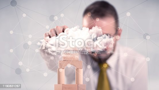 452598975 istock photo Businessman building a tower 1190831267