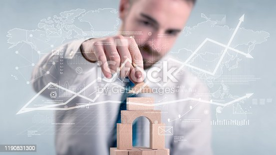 452598975 istock photo Businessman building a tower 1190831300