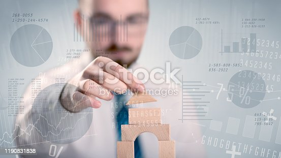 452598975 istock photo Businessman building a tower 1190831838