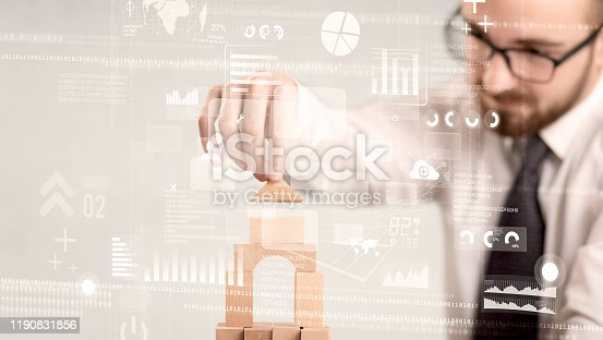 452598975 istock photo Businessman building a tower 1190831856