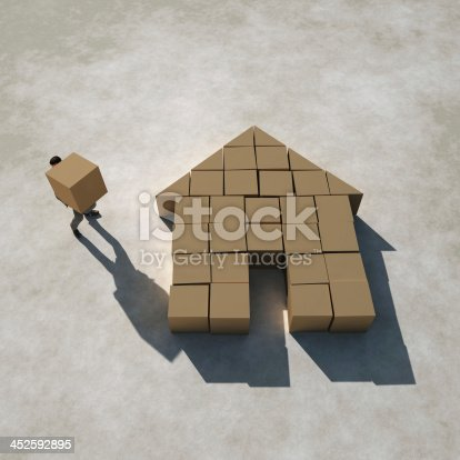 452592895 istock photo businessman builds a house 452592895