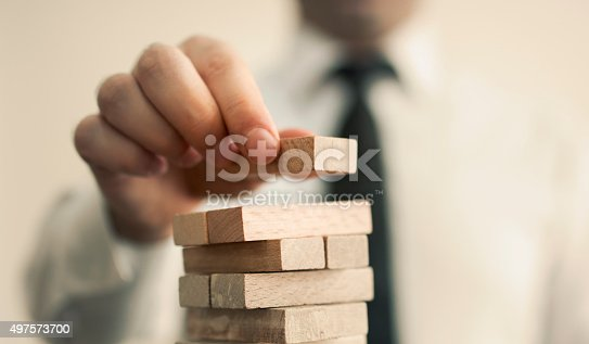 istock businessman builds a tower 497573700