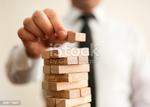 452592895 istock photo businessman builds a tower 538779647