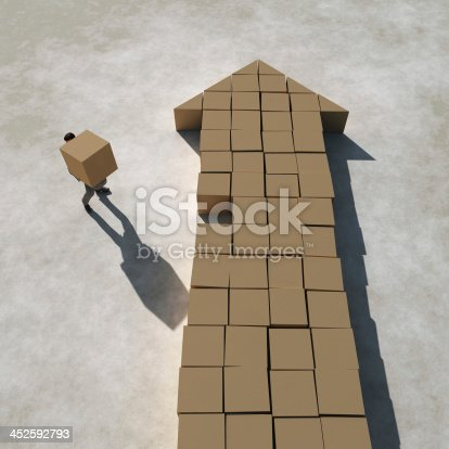 istock businessman builds arrow 452592793