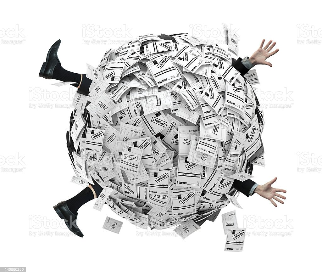Businessman buried in sphere of financial invoices stock photo