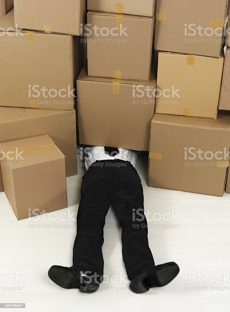 Businessman Buried Under Boxes stock photo