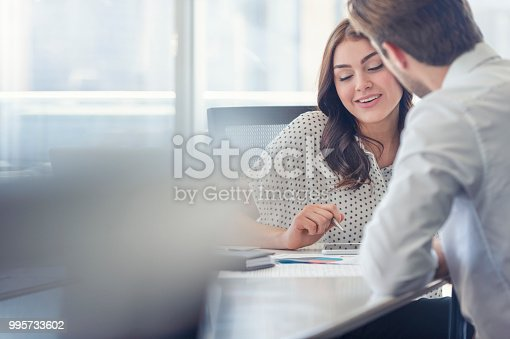995734014istockphoto Businessman business woman working together. 995733602