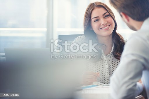 995734014istockphoto Businessman business woman working together. 995733604