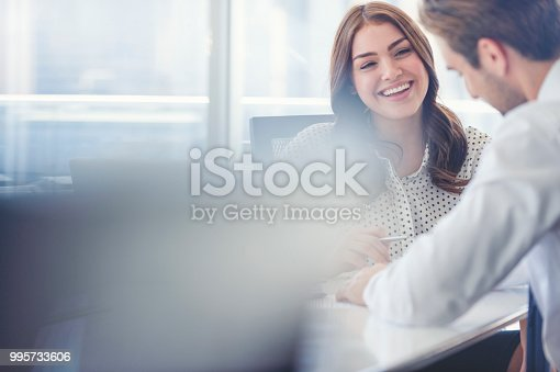 995734014istockphoto Businessman business woman working together. 995733606