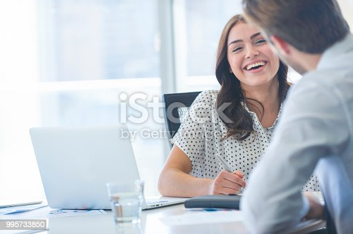 995734014istockphoto Businessman business woman working together. 995733850