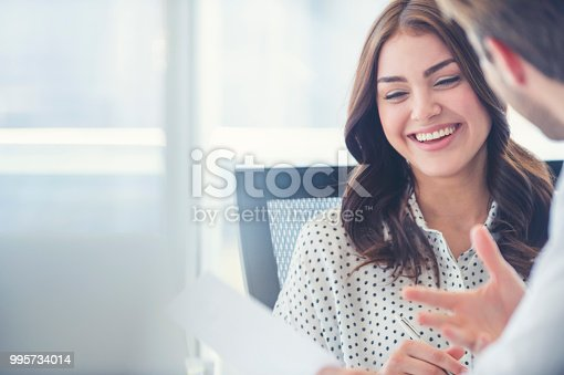 995734014istockphoto Businessman business woman working together. 995734014