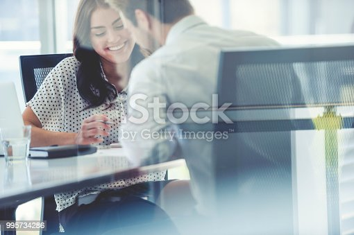 995734014istockphoto Businessman business woman working together. 995734286