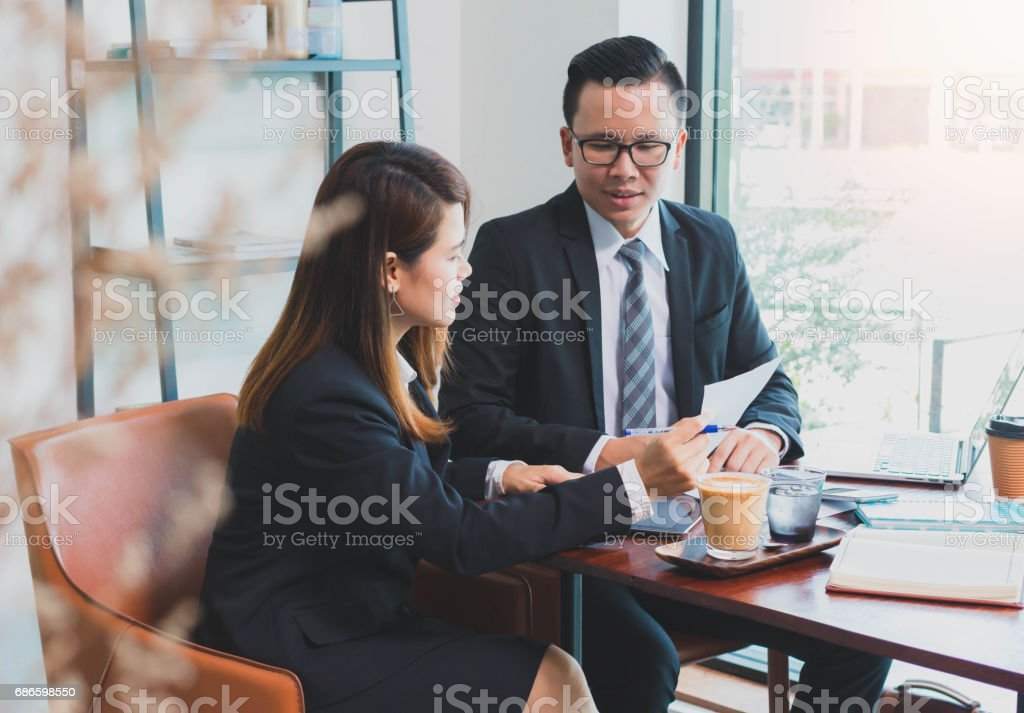 Businessman & Businesswoman consulting and discussing work at meeting table royalty-free stock photo