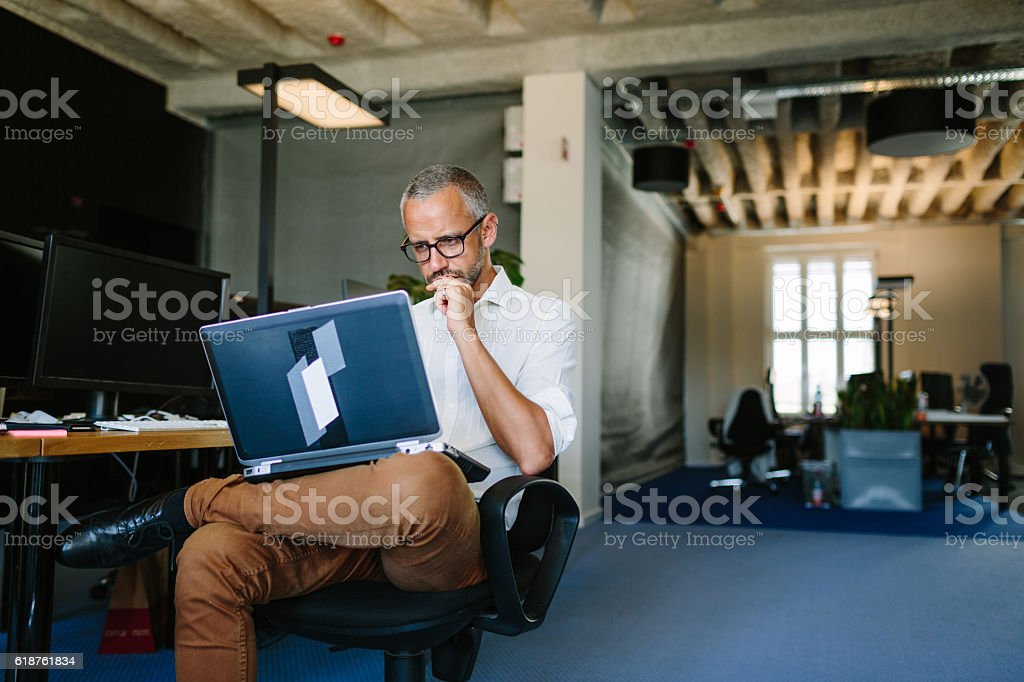 Businessman busy working on laptop stock photo