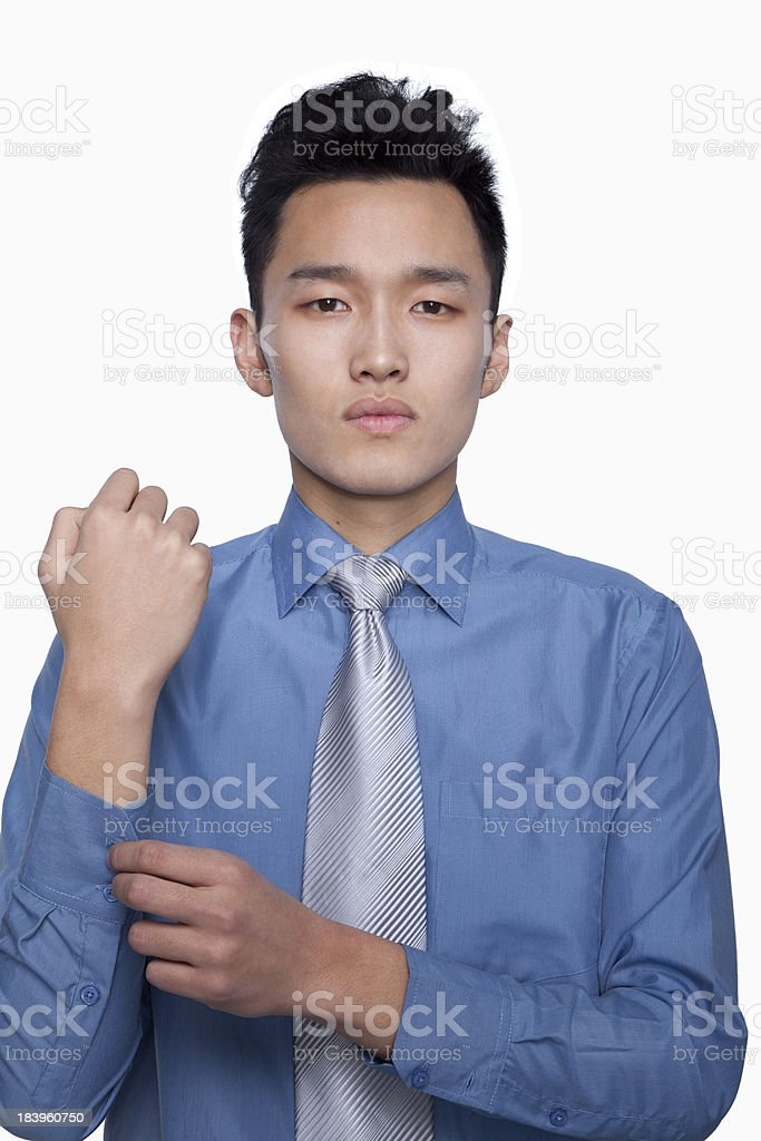 Businessman Buttoning His Sleeve royalty-free stock photo