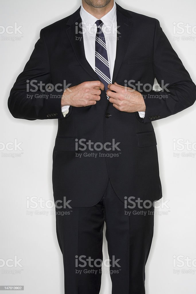 Businessman buttoning jacket royalty-free stock photo