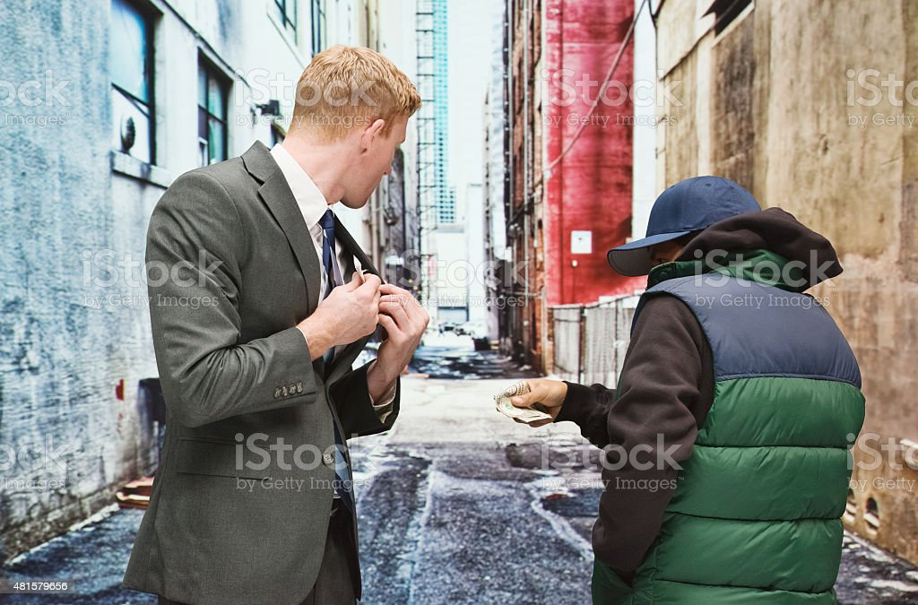 Businessman buying drugs stock photo