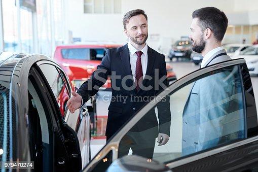 1049198210 istock photo Businessman Buying New Car 979470274