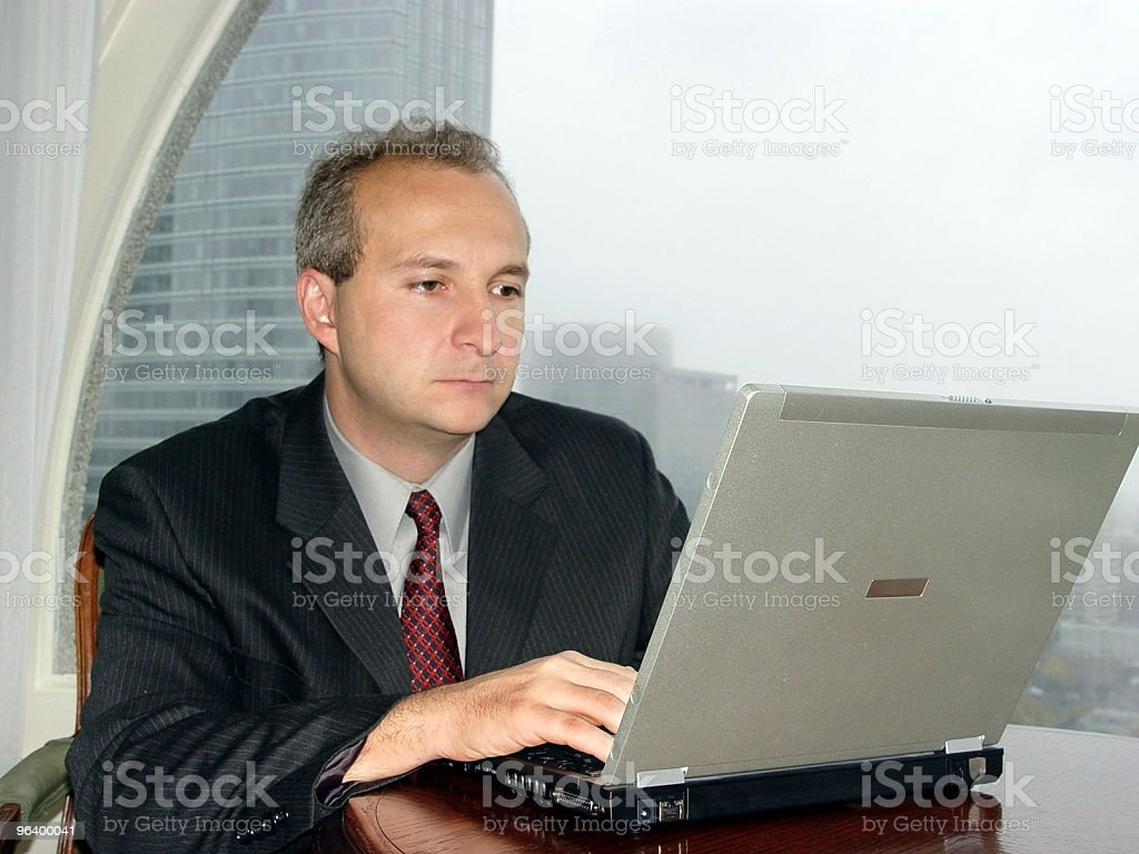 Businessman by the window royalty-free stock photo