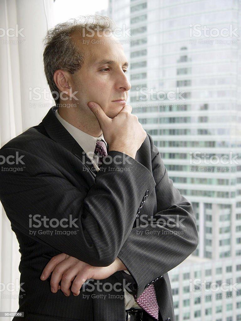 Businessman by the window stock photo
