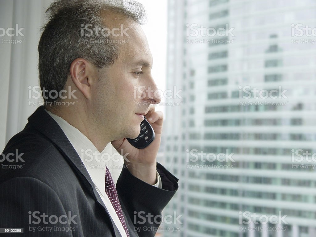 Businessman by the window - Royalty-free Adult Stock Photo