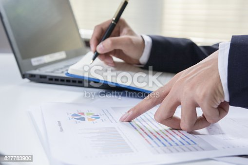 istock Businessman calculate about cost and charts report on table at home office, calculator on desk of financial planing. Finance concepts. 827783900