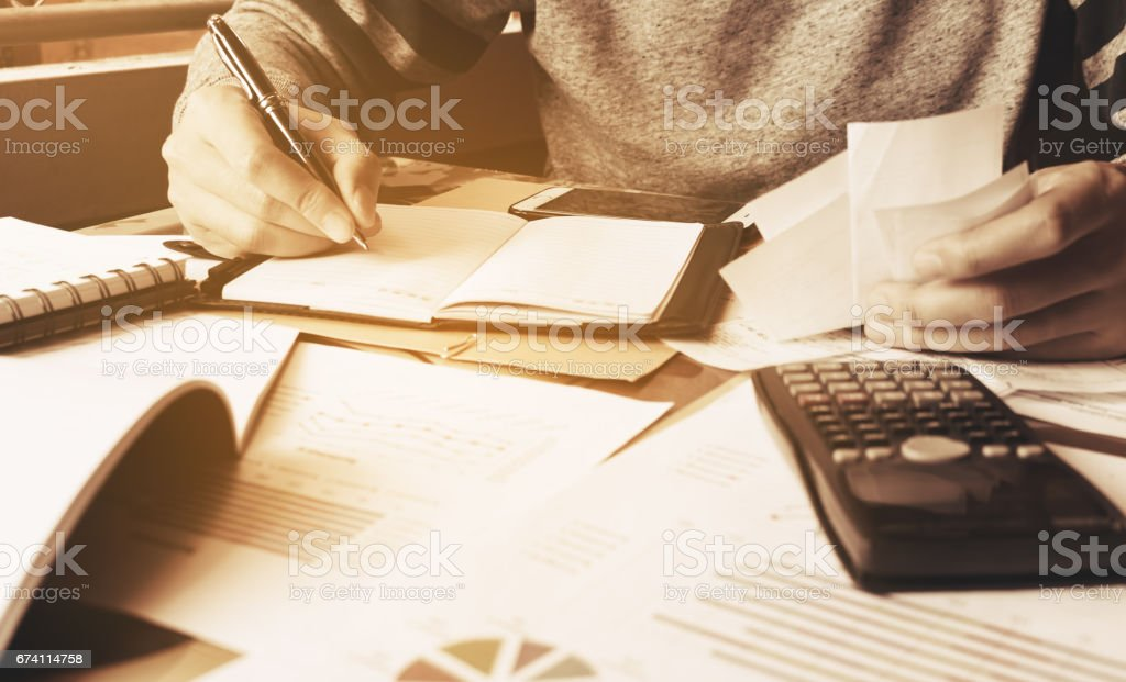 Businessman calculate finance with holding expense bill. royalty-free stock photo