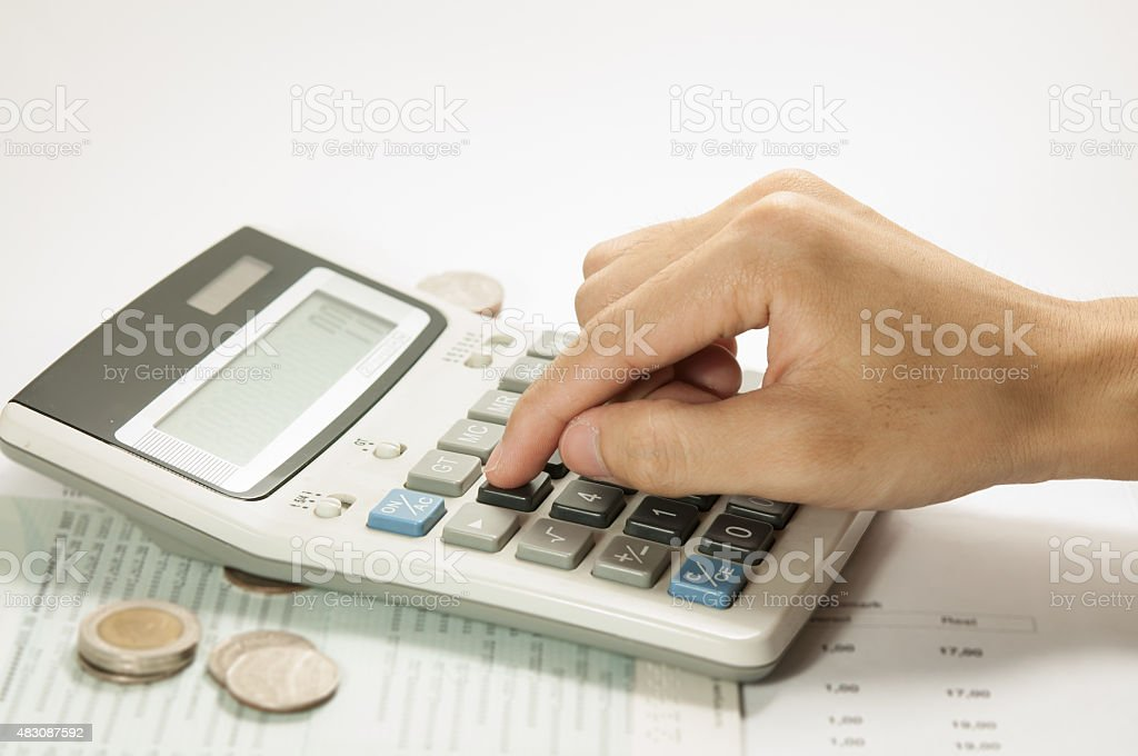 Businessman calculate on the desk in office. stock photo