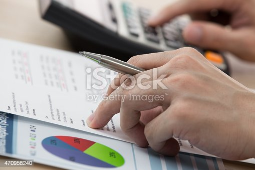 istock Businessman calculating and checking articles of agreement 470958240