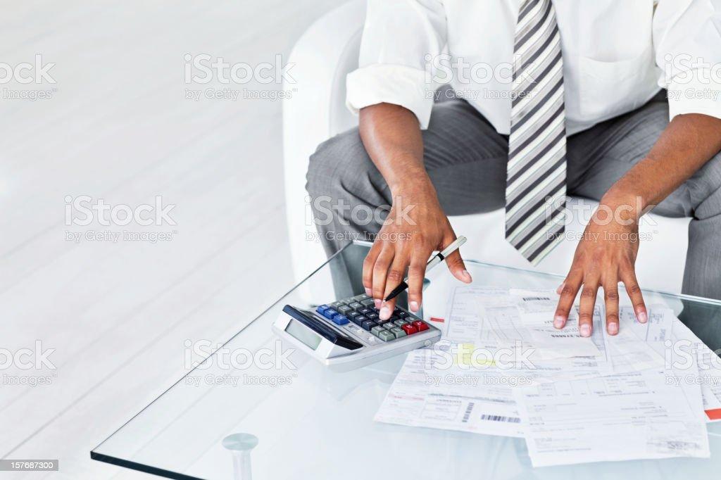Businessman Calculating Bills royalty-free stock photo