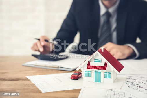 915688450 istock photo Businessman calculating budget before signing real estate project contract 955864858