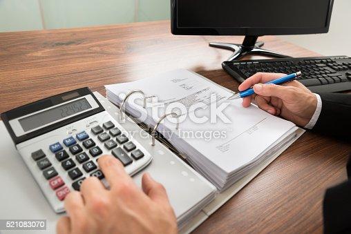 istock Businessman Calculating Invoice 521083070