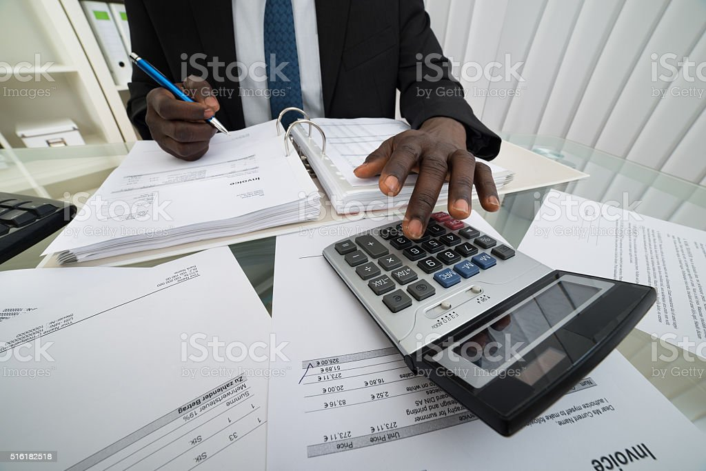Businessman Calculating Invoices stock photo