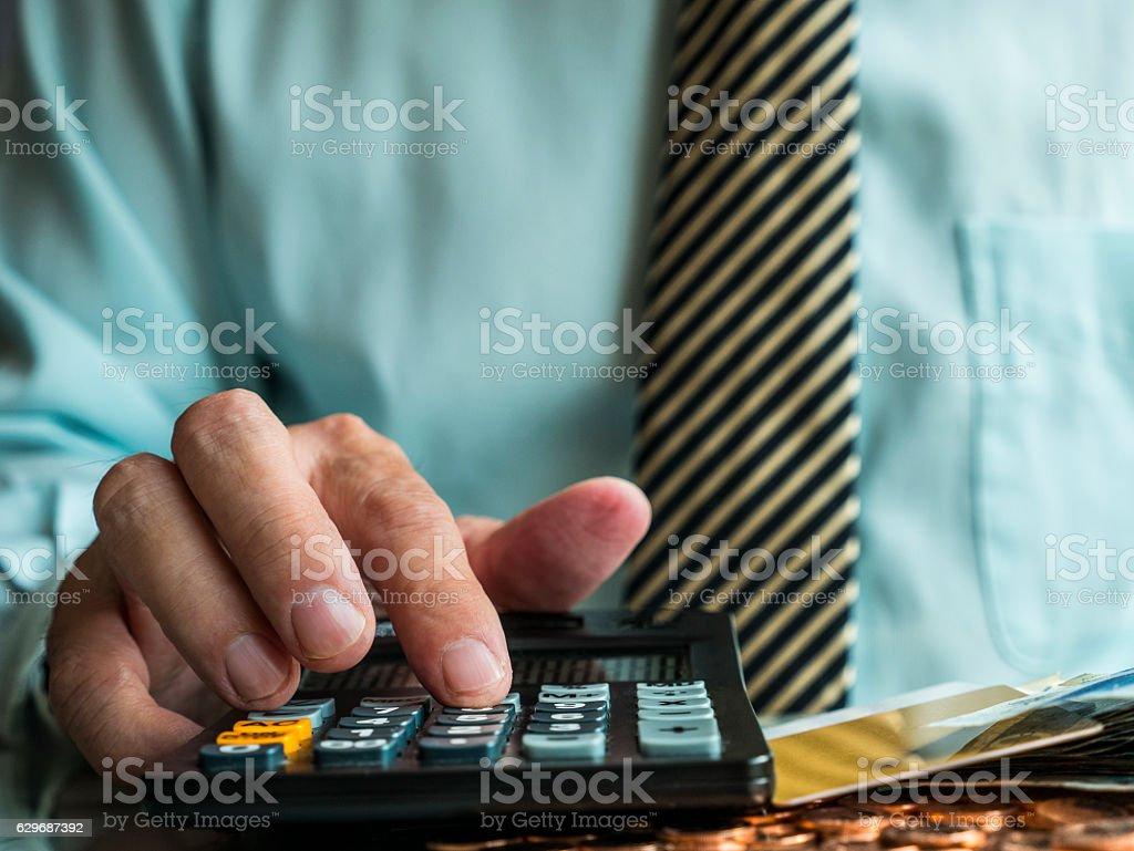 Businessman calculating profit balance stock photo