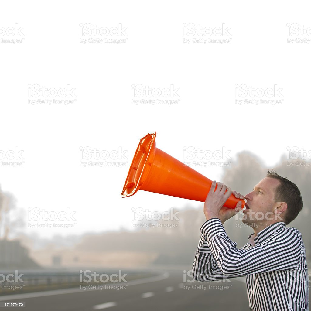 Businessman calling out for help royalty-free stock photo