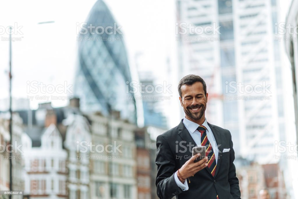 Businessman calling taxi for airport drop off stock photo