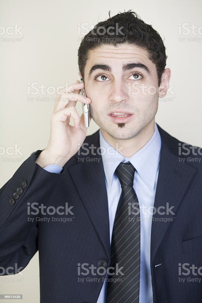 Businessman calling with a cell phone royalty-free stock photo