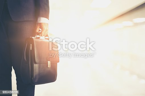 istock businessman carry a brief case,business and opportunity concept 930458226