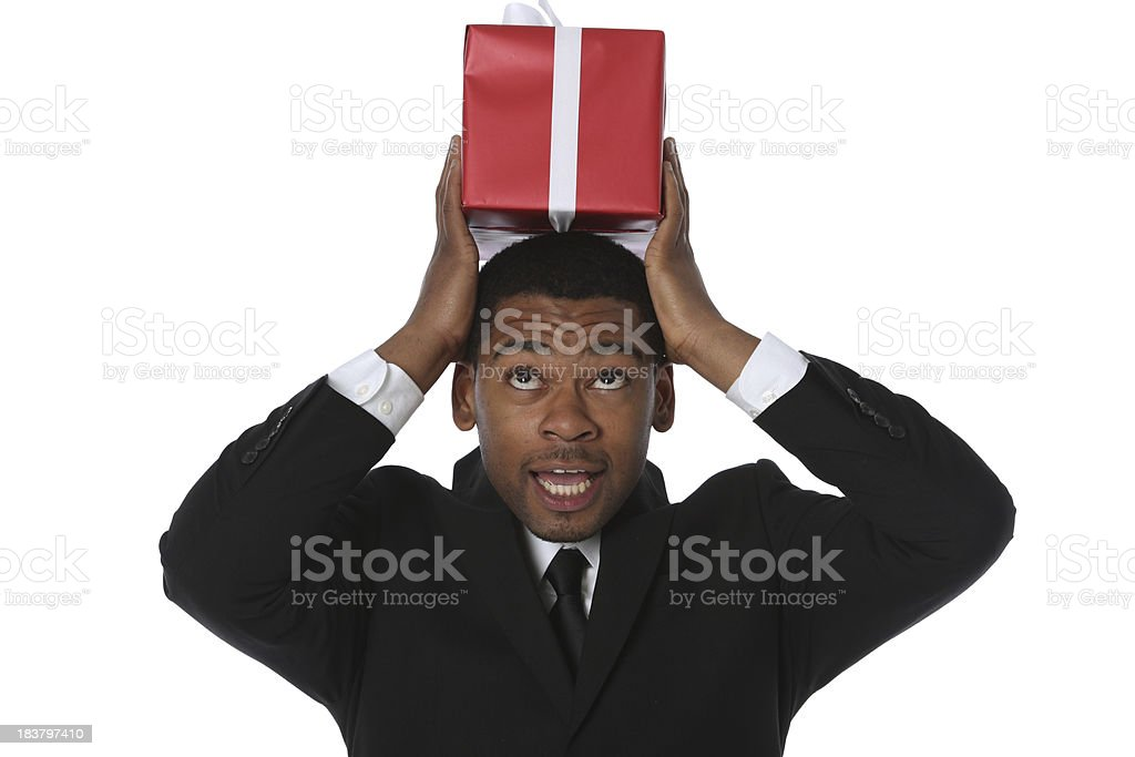 Businessman carrying a gift box on his head royalty-free stock photo
