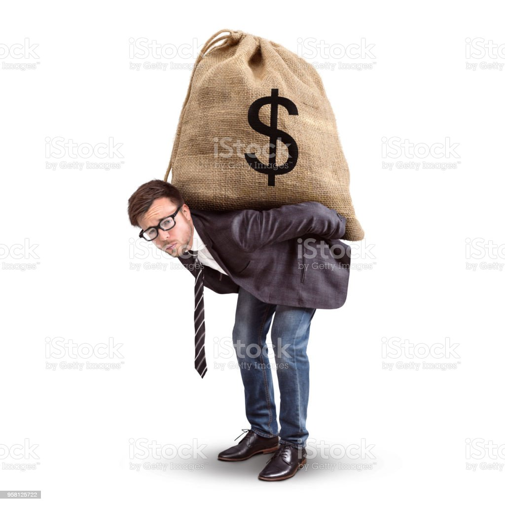 Businessman carrying an oversized moneybag stock photo