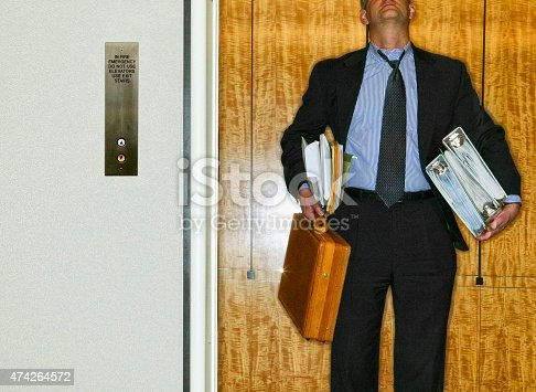 481644192 istock photo Businessman carrying briefcase and notebooks. 474264572