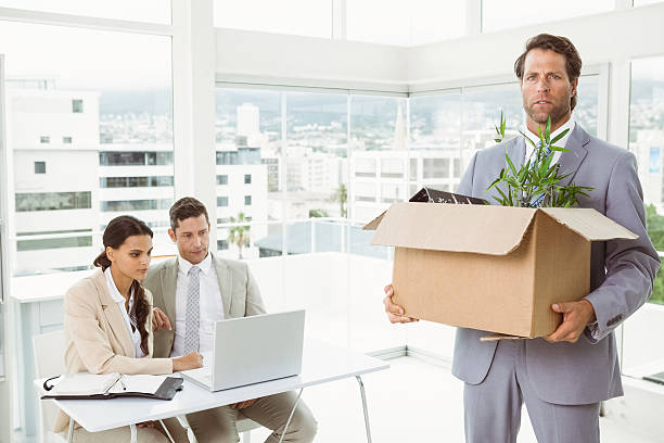 businessman carrying his belongings in box - leaving partnership corporate business sitting stock photos and pictures