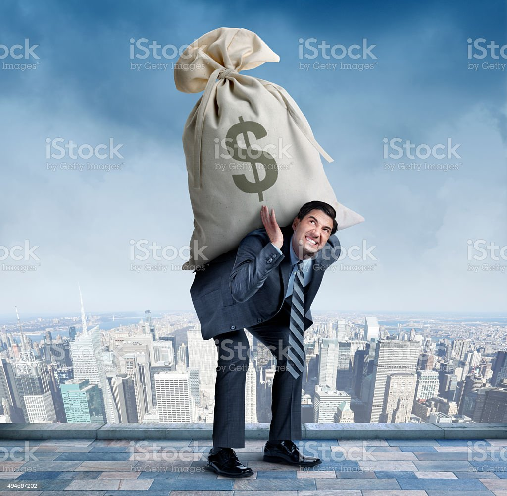 Businessman Carrying Large Money Bag stock photo