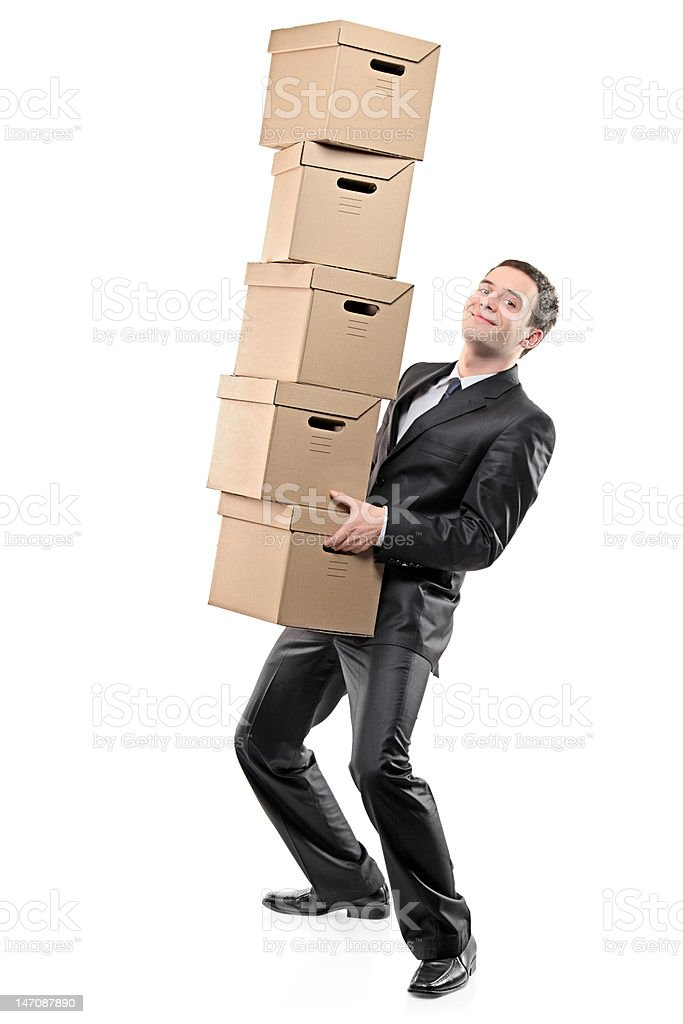Businessman carrying paper boxes royalty-free stock photo