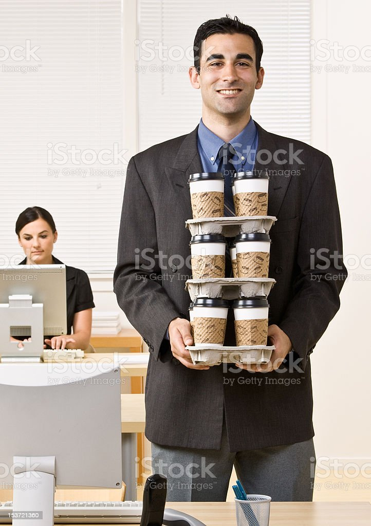 Businessman Carrying Tray of Coffee stock photo