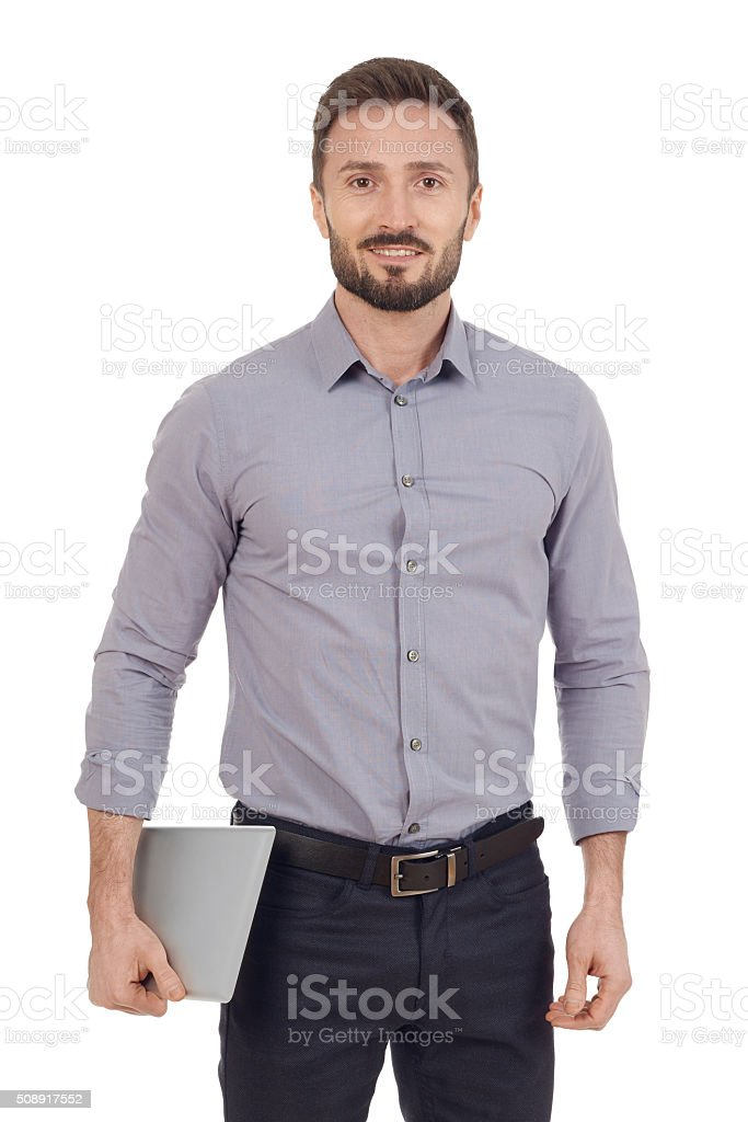 Businessman carying a digital tablet stock photo
