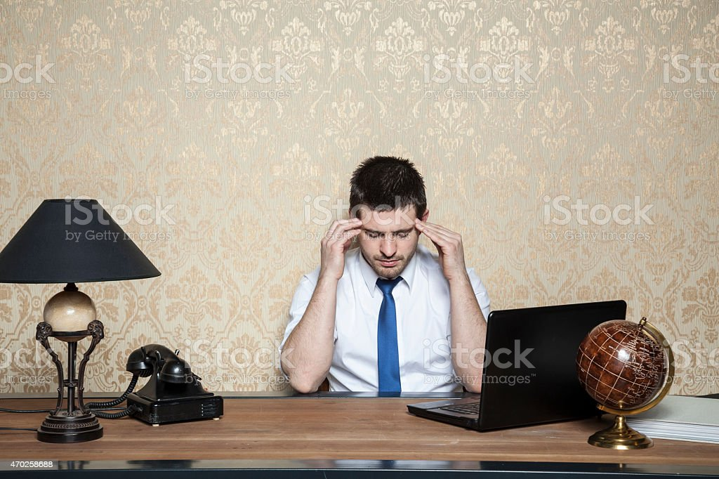 businessman caught headache stock photo