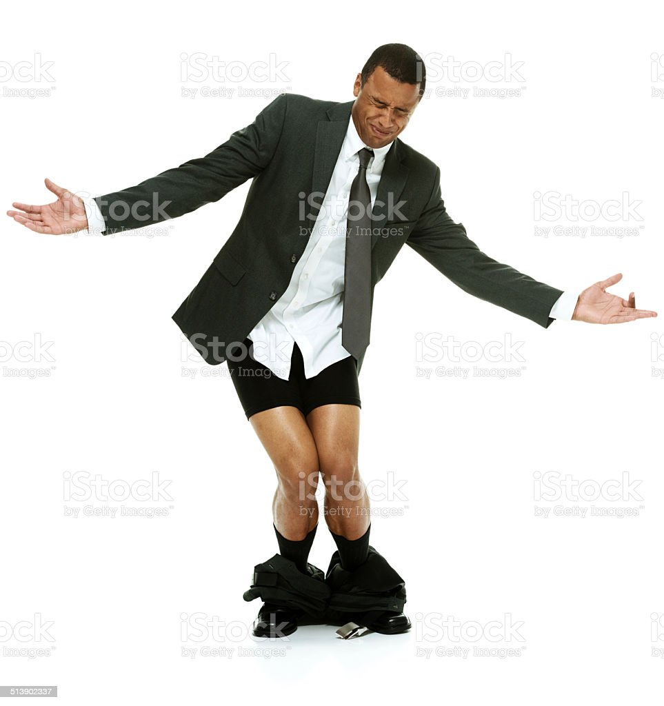 Businessman caught with his pants down stock photo